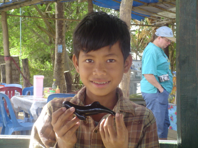 2006 Cambodia Sambo Irrawaddy river dolphins and souvenir boy 01.jpg